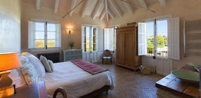 Spacious bedroom with garden views