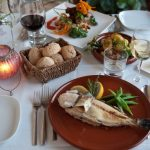 table with fish bread and wine