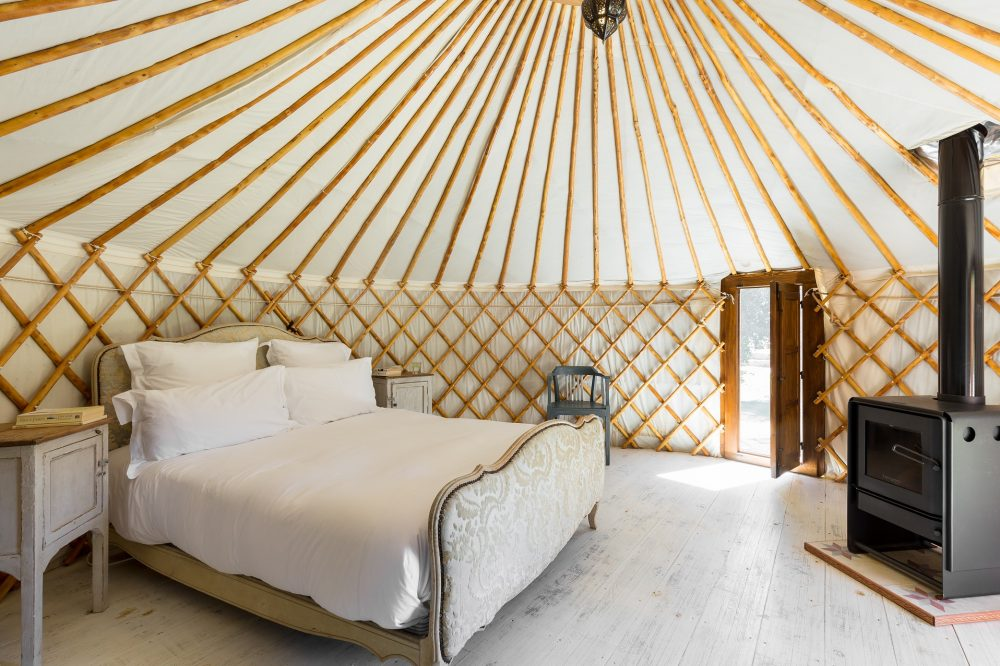Yurt double bedroom with stove
