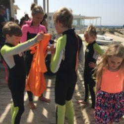 Children preparing for surf lessons
