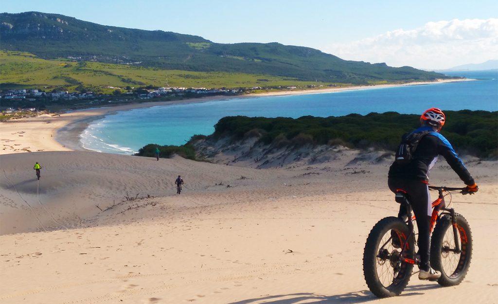 Fat biking on sand dunes in Bolonia beach